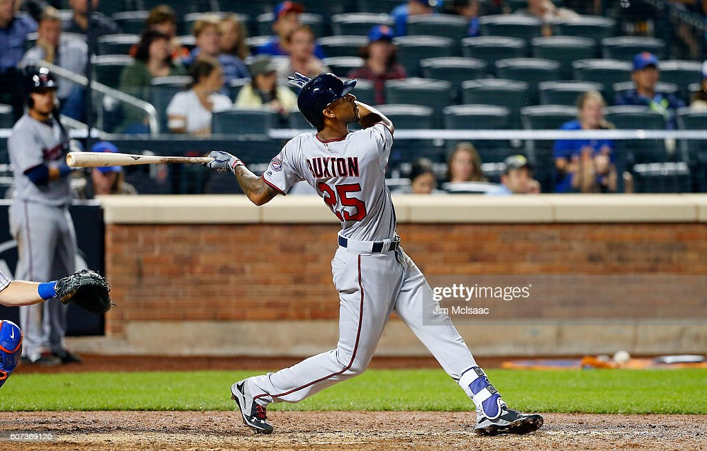 Byron Buxton #25 of the Minnesota Twins follows through on his eleventh inning home run against the New York Mets at Citi Field on September 17, 2016 in the Flushing neighborhood of the Queens borough of New York City.
