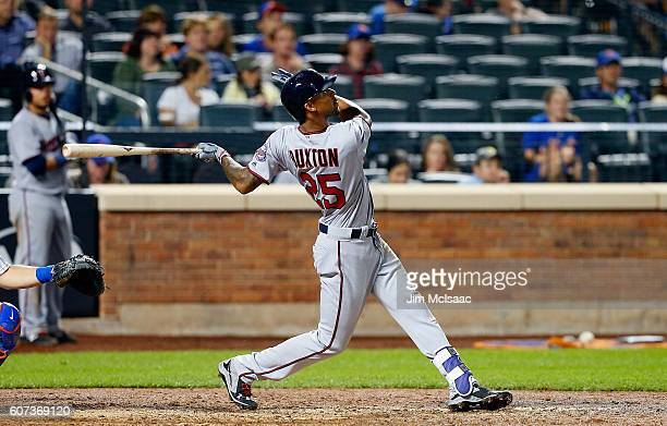 Byron Buxton of the Minnesota Twins follows through on his eleventh inning home run against the New York Mets at Citi Field on September 17 2016 in...