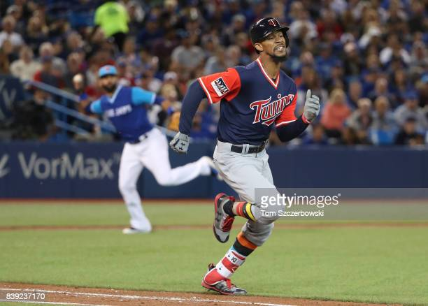 Byron Buxton of the Minnesota Twins hits a bunt single in the fifth inning as he runs to first base during MLB game action against the Toronto Blue...