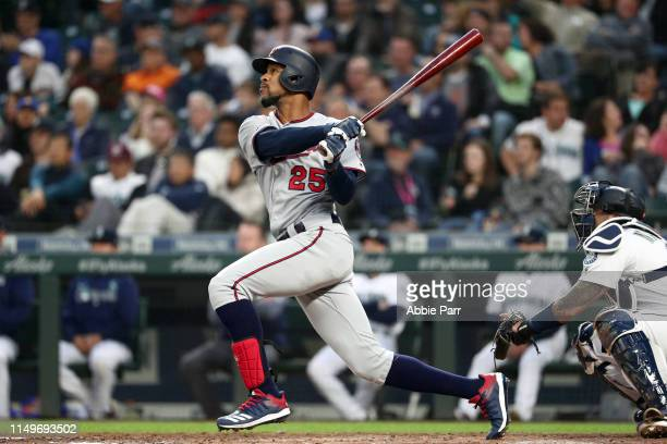 Byron Buxton of the Minnesota Twins hits a threerun home run against the Seattle Mariners in the fourth inning during their game at TMobile Park on...