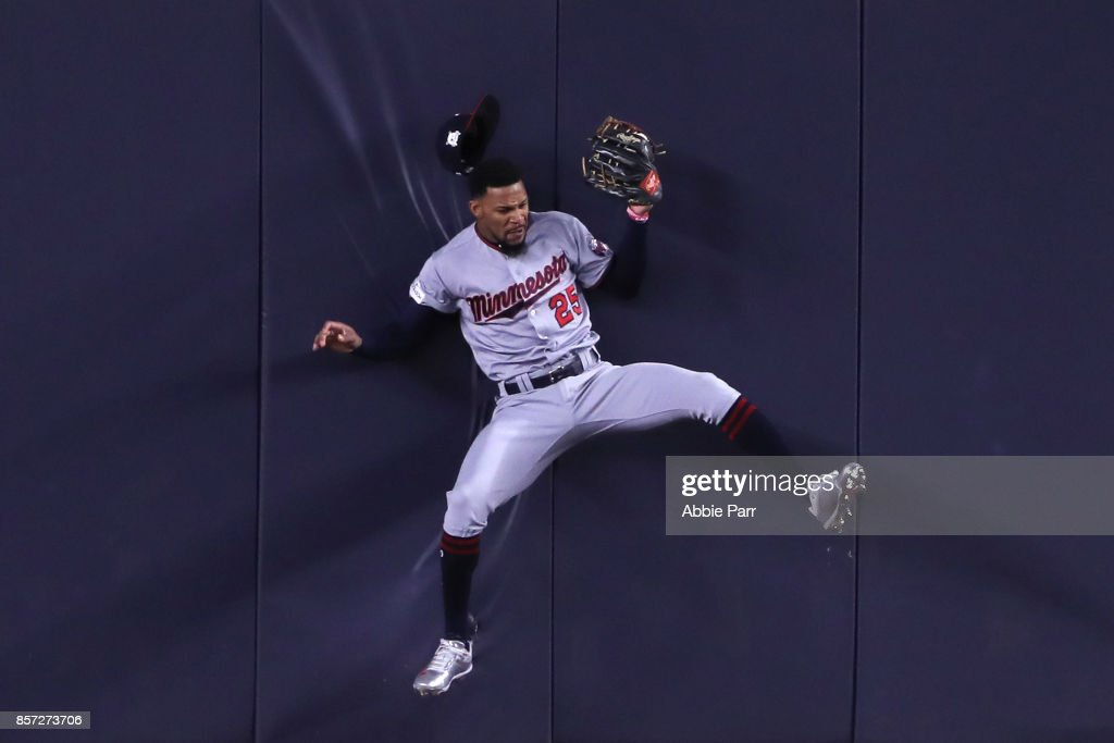 Byron Buxton #25 of the Minnesota Twins hits the wall as he catches a pop up fly against the New York Yankees during the second inning in the American League Wild Card Game at Yankee Stadium on October 3, 2017 in the Bronx borough of New York City.