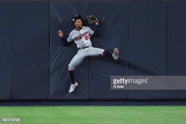 Byron Buxton of the Minnesota Twins hits the wall as he catches a pop up fly against the New York Yankees during the second inning in the American...