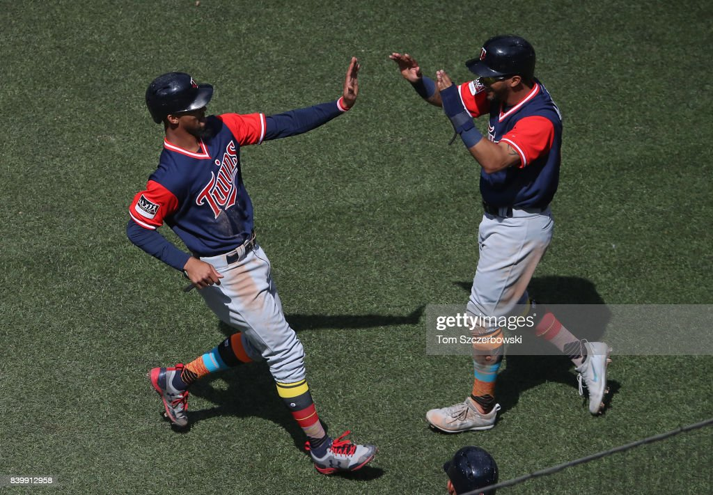 Byron Buxton #25 of the Minnesota Twins is congratulated by Eddie Rosario #20 after both runners scored on a two-run single by Kennys Vargas #19 in the third inning during MLB game action against the Toronto Blue Jays at Rogers Centre on August 27, 2017 in Toronto, Canada.