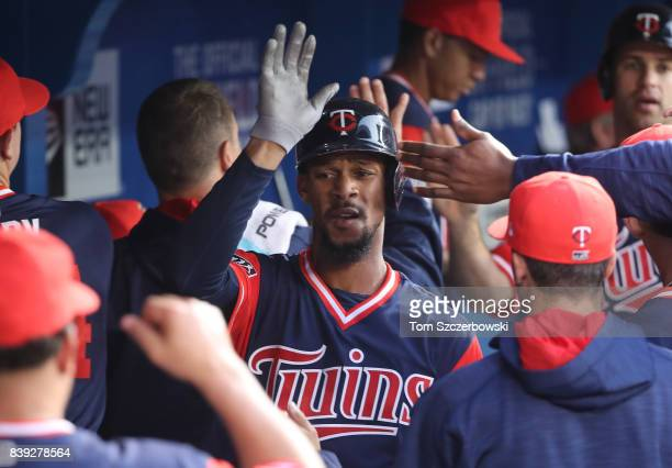 Byron Buxton of the Minnesota Twins is congratulated by teammates in the dugout after scoring a run in the third inning during MLB game action...