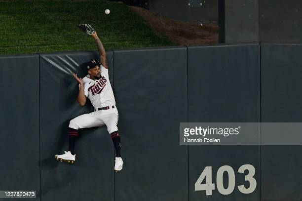 Byron Buxton of the Minnesota Twins is unable to catch the solo home run hit by Tommy Edman of the St. Louis Cardinals in center field during the...