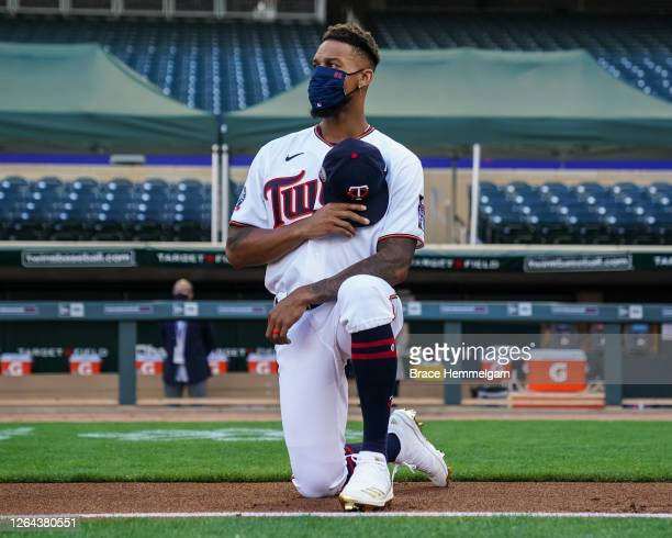 Byron Buxton of the Minnesota Twins kneels prior to the game against the St. Louis Cardinals on July 28, 2020 at the Target Field in Minneapolis,...