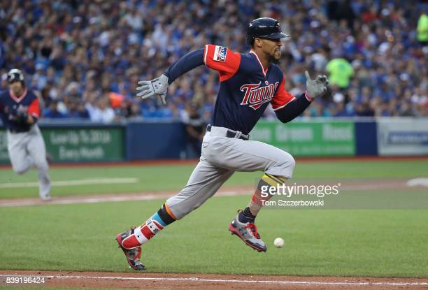 Byron Buxton of the Minnesota Twins legs out a soft RBI bunt single in the third inning during MLB game action against the Toronto Blue Jays at...