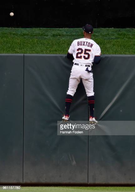 Byron Buxton of the Minnesota Twins looks on as the solo home run ball hit by Nicholas Castellanos of the Detroit Tigers clears the center field...