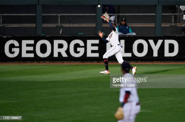 Byron Buxton of the Minnesota Twins makes a catch in center field of the ball hit by Ty France of the Seattle Mariners during the eighth inning of...