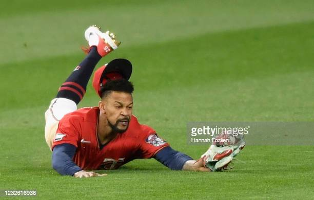 Byron Buxton of the Minnesota Twins makes a catch in center field of the ball hit by Andrew Benintendi of the Kansas City Royals during the fifth...