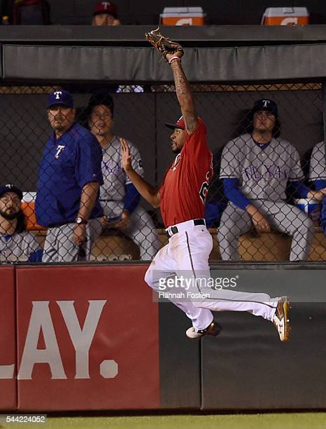 Byron Buxton of the Minnesota Twins makes a catch of the ball hit by Rougned Odor of the Texas Rangers in center field during the tenth inning of the...