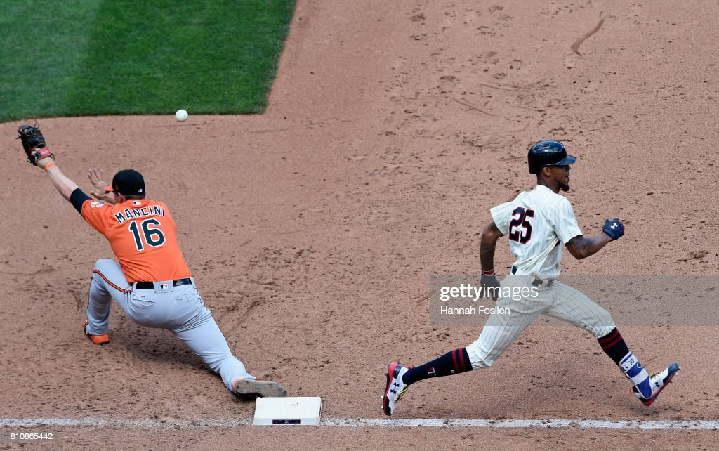 Byron Buxton #25 of the Minnesota Twins reaches first base on an infield single as Trey Mancini #16 of the Baltimore Orioles is unable to field the ball during the sixth inning of the game on July 8, 2017 at Target Field in Minneapolis, Minnesota. The Orioles defeated the Twins 5-1.