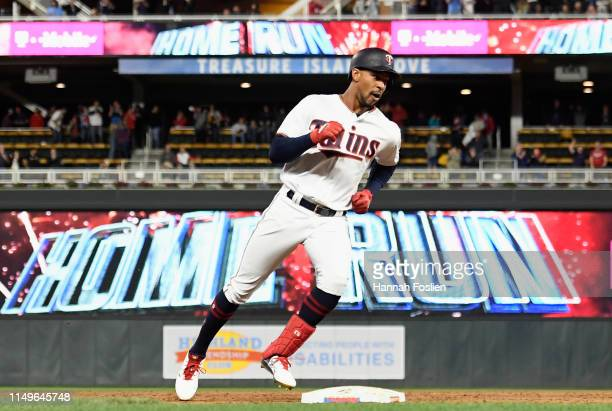Byron Buxton of the Minnesota Twins rounds the bases after hitting a tworun home run against the Seattle Mariners during the ninth inning of the game...