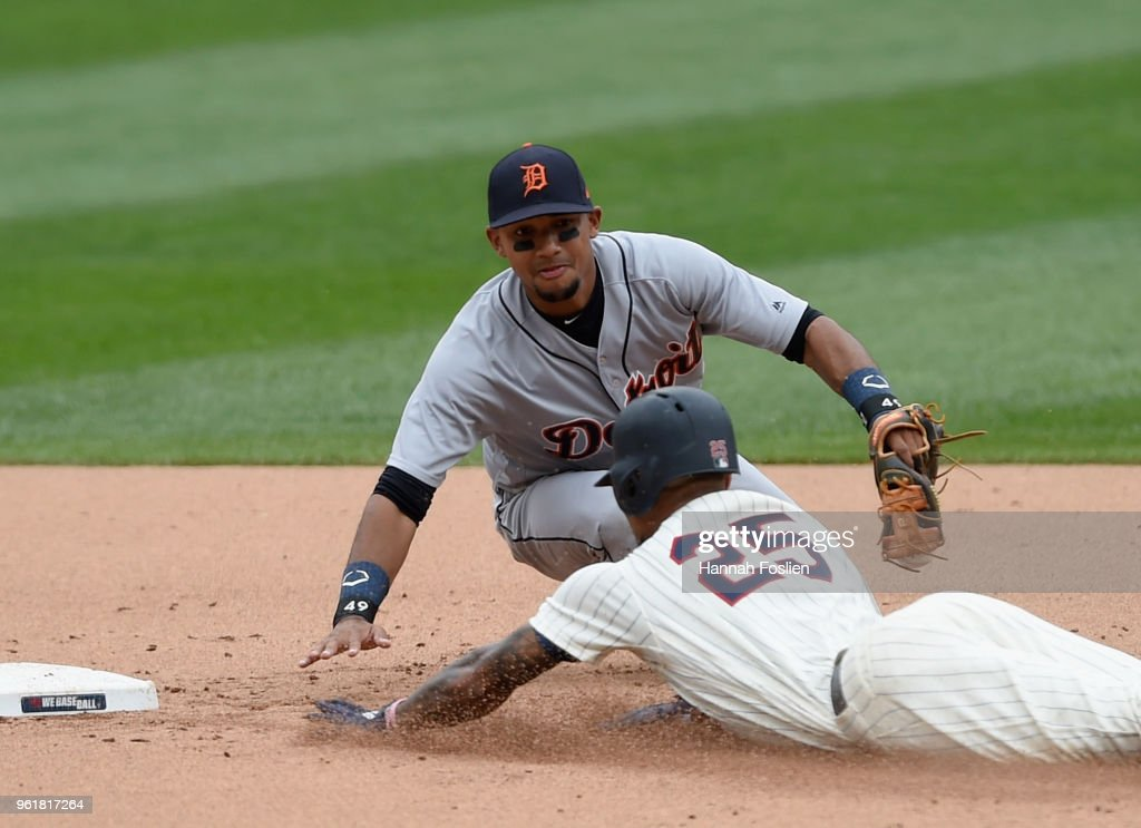 Byron Buxton #25 of the Minnesota Twins slides safely into second base with a double as Dixon Machado #49 of the Detroit Tigers applies the tag during the fifth inning of the game on May 23, 2018 at Target Field in Minneapolis, Minnesota. The Tigers defeated the Twins 4-1.