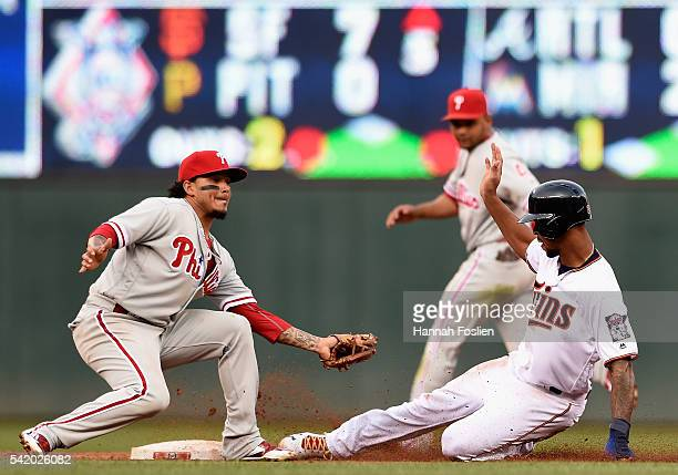 Byron Buxton of the Minnesota Twins steals second base against Freddy Galvis of the Philadelphia Phillies during the second inning of the game on...