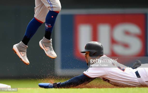 Byron Buxton of the Minnesota Twins steals second base as Freddy Galvis of the Toronto Blue Jays fields the ball during the second inning of the game...