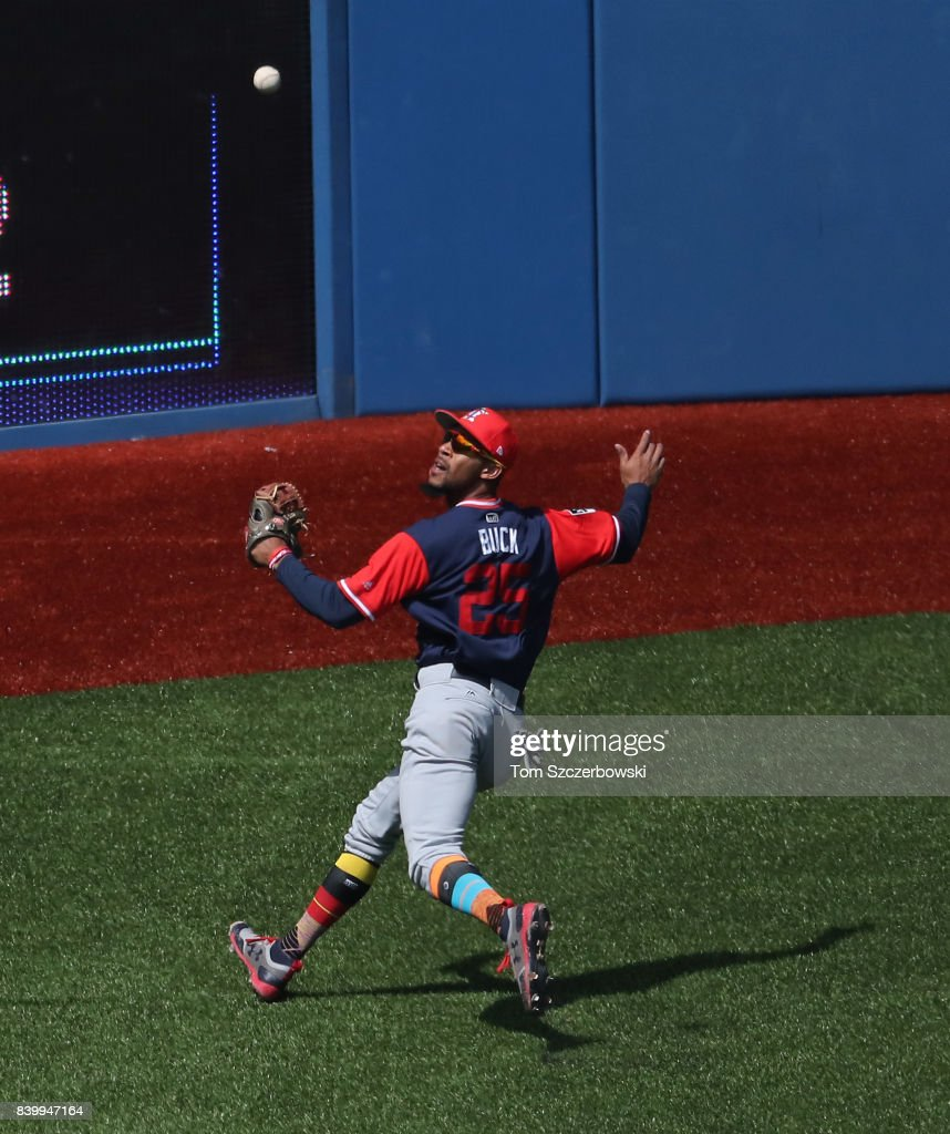 Byron Buxton #25 of the Minnesota Twins watches a high hop go over his head in the second inning during MLB game action as Miguel Montero #47 of the Toronto Blue Jays hits a double at Rogers Centre on August 27, 2017 in Toronto, Canada.