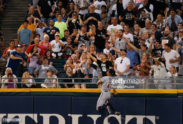 Byron Buxton of the Minnesota Twins watches the home run ball hit by Adam Engel of the Chicago White Sox during the third inning of a game at...