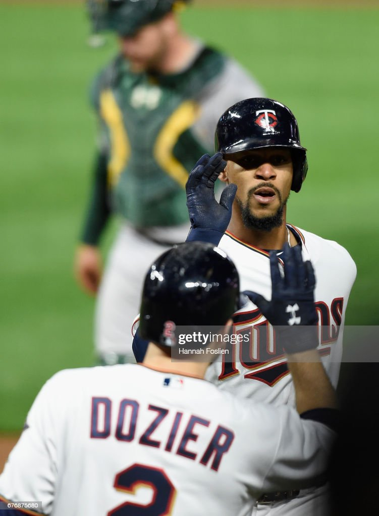 Byron Buxton #25 of the of the Minnesota Twins is congratulated by teammate Brian Dozier #2 on a solo home run against the Oakland Athletics during the seventh inning of the game on May 2, 2017 at Target Field in Minneapolis, Minnesota. The Twins defeated the Athletics 9-1.