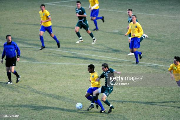 Byron Cephers of Fort Lewis and David Palmer of LeesMcRae battle for the ball during the Division II Men's Soccer Championship held at Pepin Stadium...