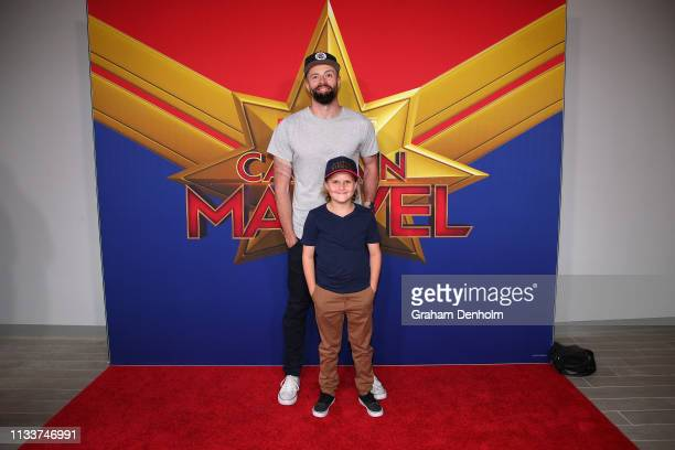 Byron Cooke and his son attend the Marvel Studios' Captain Marvel Premiere at Hoyts The District Docklands on March 05 2019 in Melbourne Australia