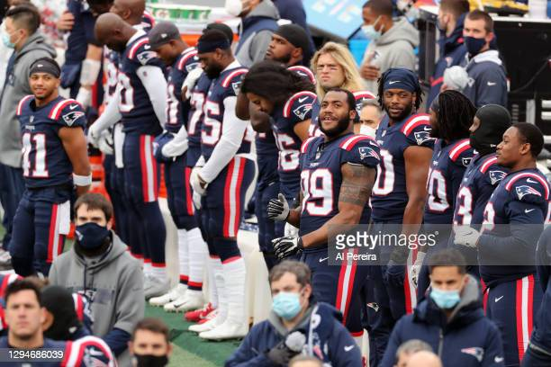 Byron Cowart of the New England Patriots enjoys the National Anthem before the game against the New York Jets at Gillette Stadium on January 3, 2021...