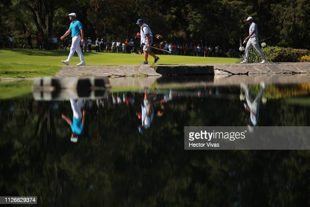 Byron DeChambeau and Tiger Woods of United States walk into the 6th tee during the first round of World Golf ChampionshipsMexico Championship at Club...