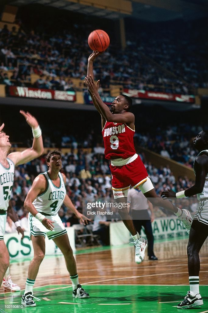 Byron Dinkins #9 of the Houston Rockets goes up for a shot against the Boston Celtics during a game played in 1990 at the Boston Garden in Boston, Massachusetts.