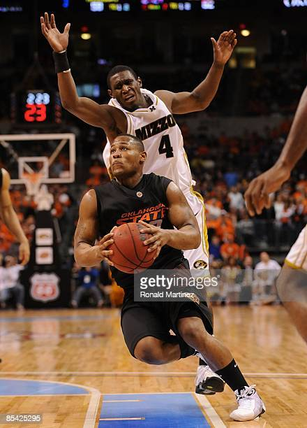 Byron Eaton of the Oklahoma State Cowboys during the Phillips 66 Big 12 Men's Basketball Championship Semifinals at the Ford Center March 13 2009 in...