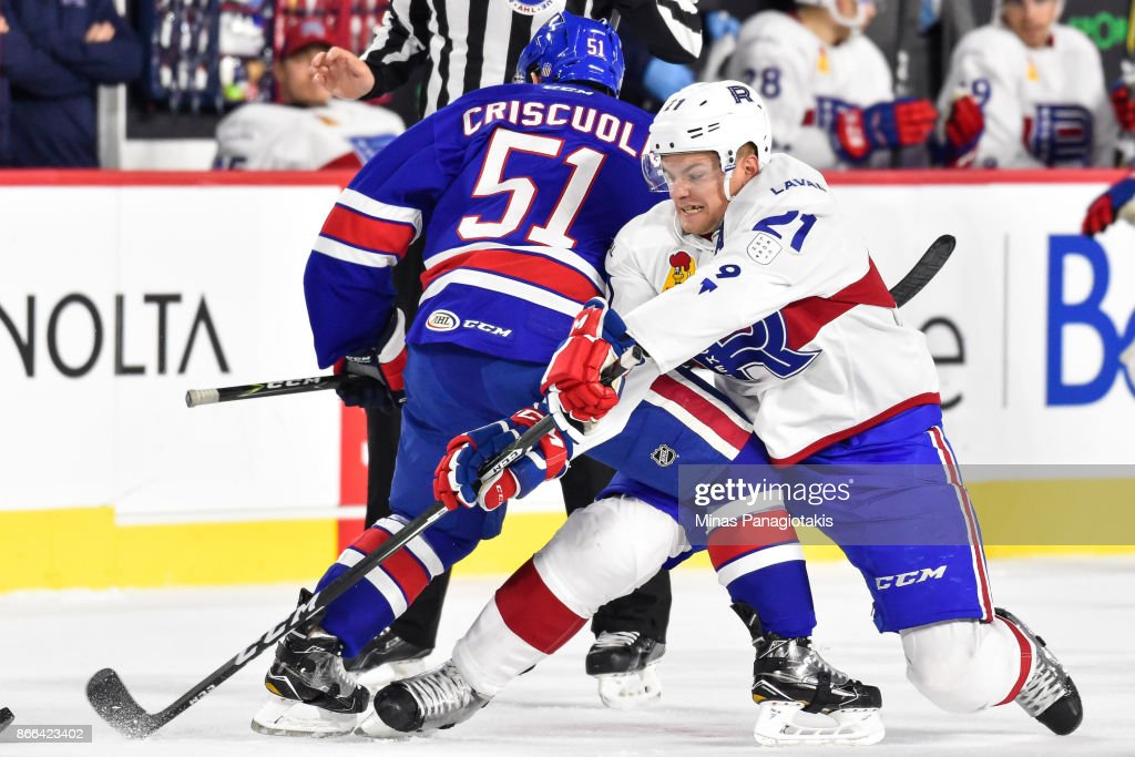 Byron Froese #21 of the Laval Rocket gets tangled up with Kyle Criscuolo #51 of the Rochester Americans after a face-off during the AHL game at Place Bell on October 25, 2017 in Montreal, Laval, Canada.