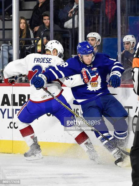 Byron Froese of the Laval Rocket holds Travis Dermott of the Toronto Marlies against the boards during the AHL game at Place Bell on November 1 2017...