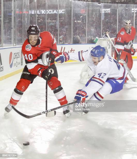 Byron Froese of the Montreal Canadiens battles for the loose puck with Gabriel Dumont of the Ottawa Senators during the 2017 Scotiabank NHL 100...