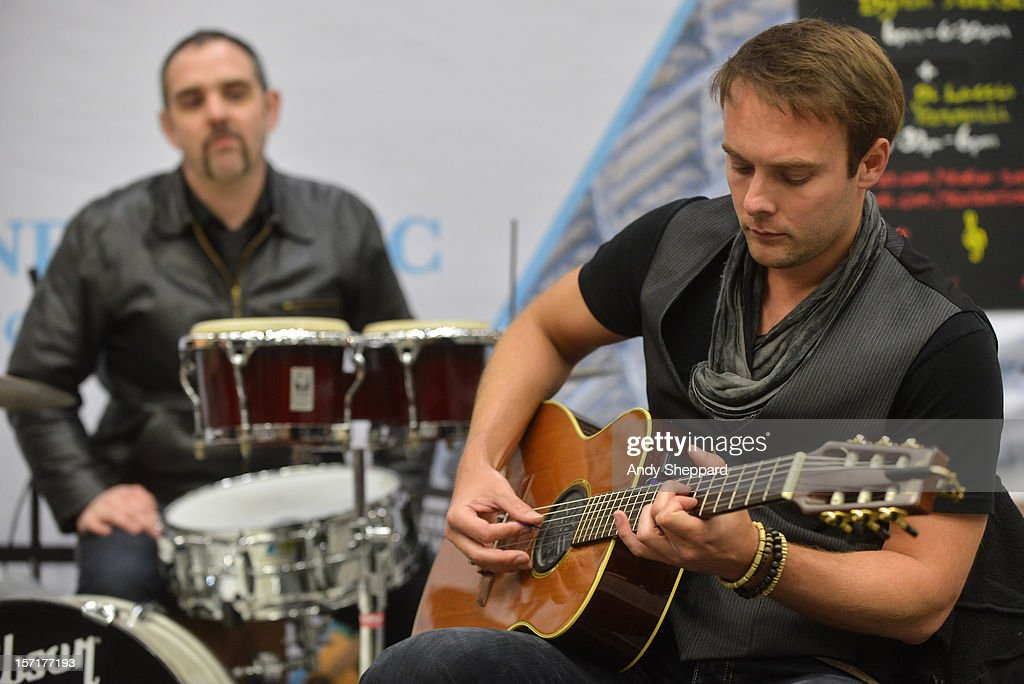 Byron Johnston (R) performs as part of the Station Sessions 2012 at St Pancras Station on November 29, 2012 in London, England.