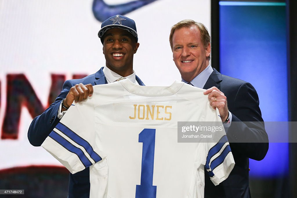 Byron Jones of the Connecticut Huskies holds up a jersey with NFL Commissioner Roger Goodell after being picked #27 overall by the Dallas Cowboys during the first round of the 2015 NFL Draft at the Auditorium Theatre of Roosevelt University on April 30, 2015 in Chicago, Illinois.