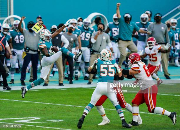 Byron Jones of the Miami Dolphins intercepts the ball against the Kansas City Chiefs at Hard Rock Stadium on December 13, 2020 in Miami Gardens,...