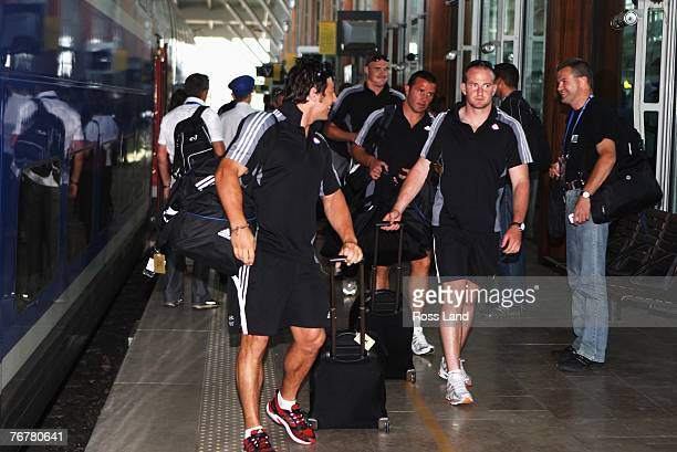Byron kelleher Keith Robinson Aaron Mauger and Brendon Leonard of the New Zealand All Blacks step off the TGV high speed train on September 16 2007...