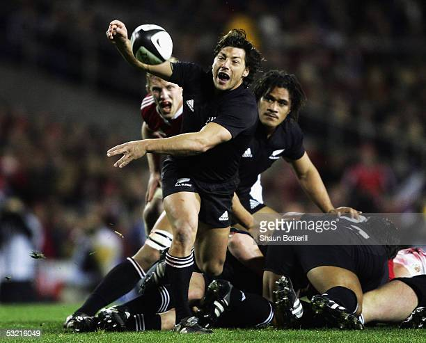 Byron Kelleher of the All Blacks passes the ball from the scrum during the third test match between the New Zealand All Blacks and the British and...