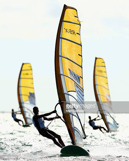 Byron Kokkalanis of Greece competes in the RS:X Men's Windsurfer Medal race on the Centre Course during day 16 of the ISAF Sailing World...