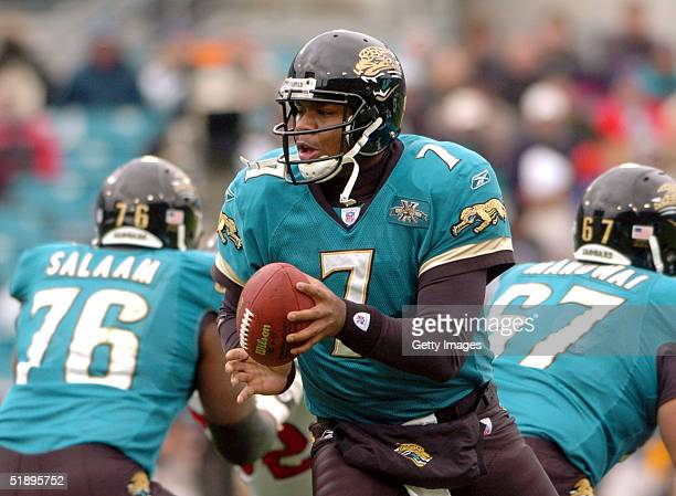 Byron Leftwich of the Jacksonville Jaguars drops back with the ball against the Houston Texans at ALLTEL Stadium December 26 2004 in Jacksonville...