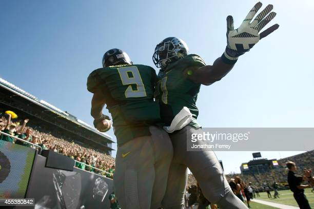 Byron Marshall of the Oregon Ducks celebrates a touchdown run with teamate Royce Freeman against the Wyoming Cowboys to run for a touchdown at Autzen...