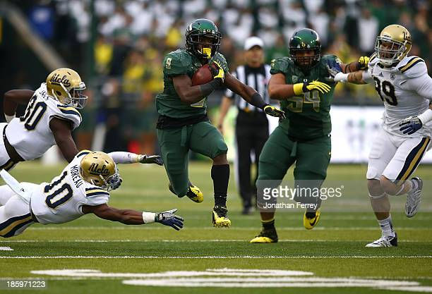 Byron Marshall of the Oregon Ducks runs for a touchdown past Fabian Moreau and Myles Jacks of the UCLA Bruins on October 26 2013 at the Autzen...