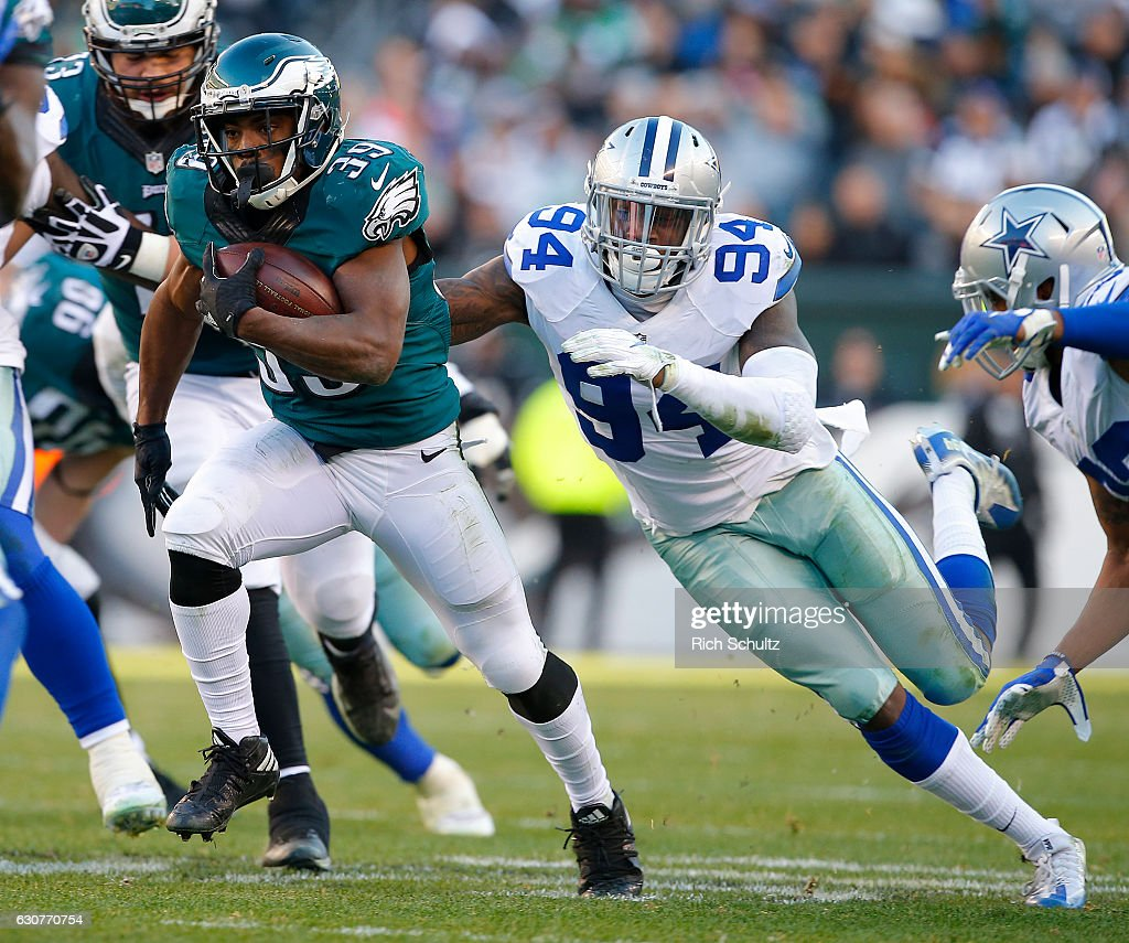 Byron Marshall #39 of the Philadelphia Eagles runs from Randy Gregory #94 of the Dallas Cowboys during the fourth quarter of a game at Lincoln Financial Field on January 1, 2017 in Philadelphia, Pennsylvania. The Eagles defatted the Cowboys 27-13.