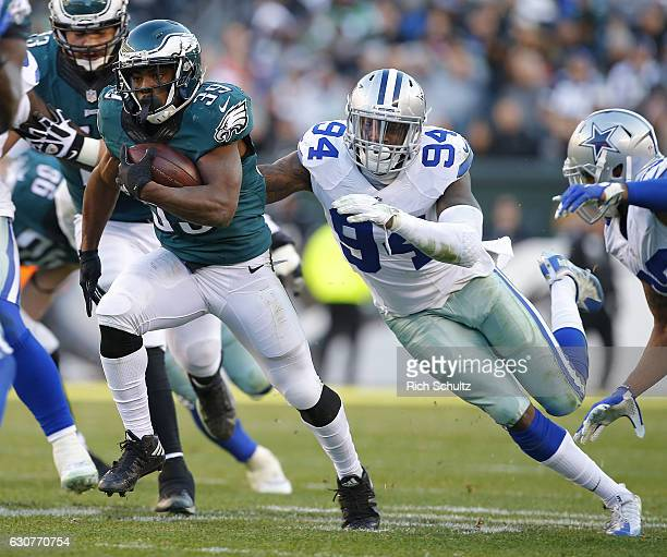 Byron Marshall of the Philadelphia Eagles runs from Randy Gregory of the Dallas Cowboys during the fourth quarter of a game at Lincoln Financial...