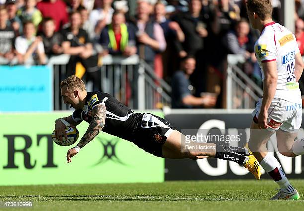 Byron McGuigan of Exeter dives over to score a try during the Aviva Premiership match between Exeter Chiefs and Sale Sharks at Sandy Park on May 16...
