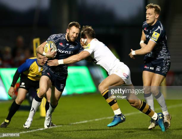 Byron McGuigan of Sale is tackled by Josh Bassett of Wasps during the Aviva Premiership match between Sale Sharks and Wasps at AJ Bell Stadium on...