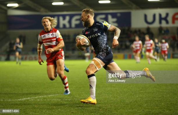 Byron McGuigan of Sale Sharks breaks away to score his third try during the Aviva Premiership match between Sale Sharks and Gloucester Rugby at AJ...