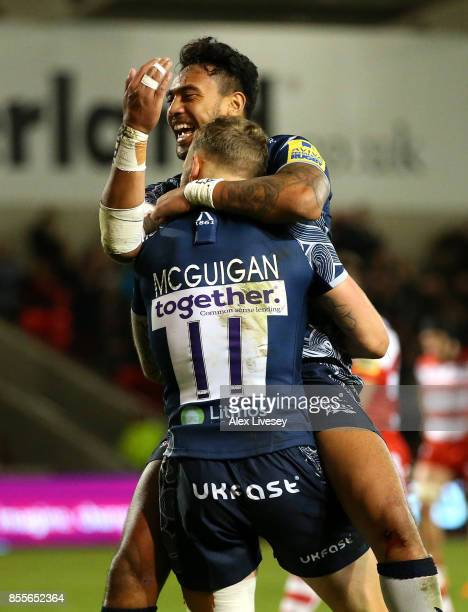 Byron McGuigan of Sale Sharks celebrates with Denny Solomona after scoring his third try during the Aviva Premiership match between Sale Sharks and...