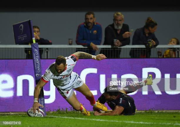 Byron McGuigan of Sale Sharks dives in to score a second half try during the Challenge Cup match between Perpignan and Sale Sharks at Stade Aime...