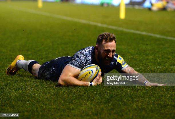 Byron McGuigan of Sale Sharks dives in to score their second try during the Aviva Premiership match between Sale Sharks and Bath Rugby at AJ Bell...