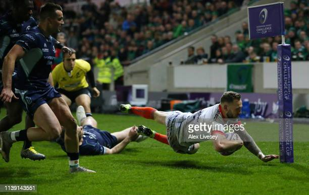 Byron McGuigan of Sale Sharks dives over to score his side's first try during the Challenge Cup Quarter Final match between Sale Sharks and Connacht...